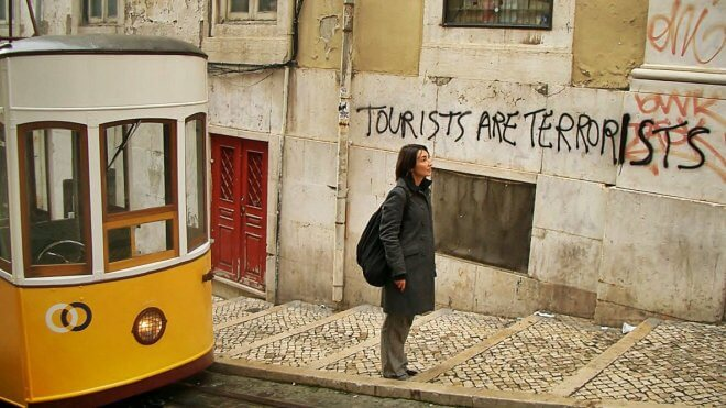 Anti-Tourism Graffiti in Lisbon: Tourists Are Terrorists