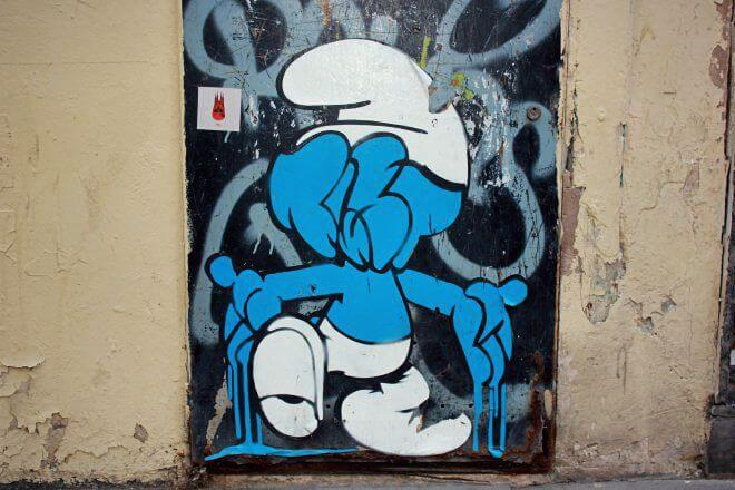 Street Art in Barcelona: Smurf Face by Bustart